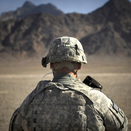 U.S. Army 1st Lt. Shawn Meno stands guard outside a meeting between reconstruction officials and members of a local Kuchi tribe residing in Bawka District in Farah province, Afghanistan, June 12, 2010 (Image: Rylan K. Albright / US Army)
